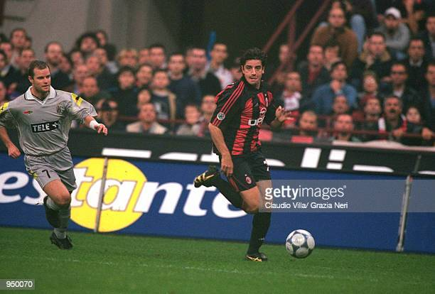 Francesco Coco of AC Milan runs down the wing during the Italian Serie A match against Juventus played at the San Siro in Milan Italy The match ended...