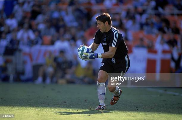 Goallie Tony Meola of the Kansas City Wizards is looking down the field with the ball during the MLS Cup 2000 game against the Chicago Fire at the...