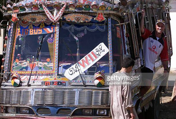 Graham Thorpe of England with a local bus after their net practice at the National Stadium in Karachi Pakistan Mandatory Credit Laurence...