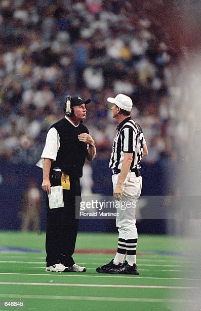 Head Coach Tom Coughlin of the Jacksonville Jaguars listens to Referee Bill Carollo on the field during the game against the Dallas Cowboys at the...