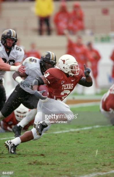 Hodges Mitchell of the Texas Longhorns runs with the ball during the game against the Missouri Tigers at the Royal Rexas Stadium in Austin Texas The...