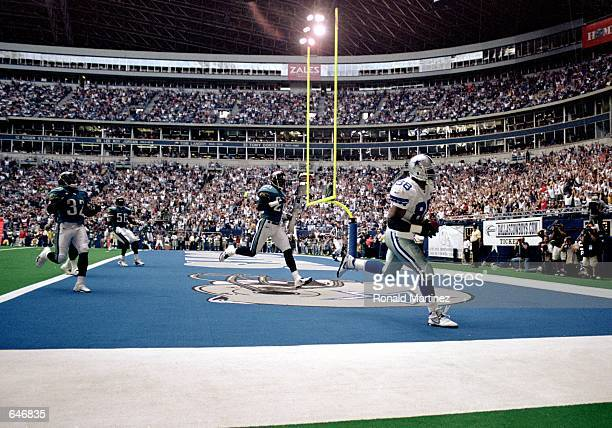 Jackie Harris of the Dallas Cowboys makes a touchdown during the game against the Jacksonville Jaguars at the Texas Stadium in Irving Texas The...