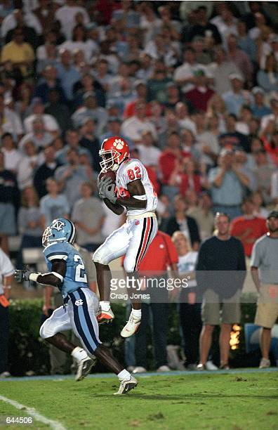 Jackie Robinson of the Clemson Tigers jumps and catches the ball as Kevin Knight of the North Carolina Tar Heels runs by him during the game at the...