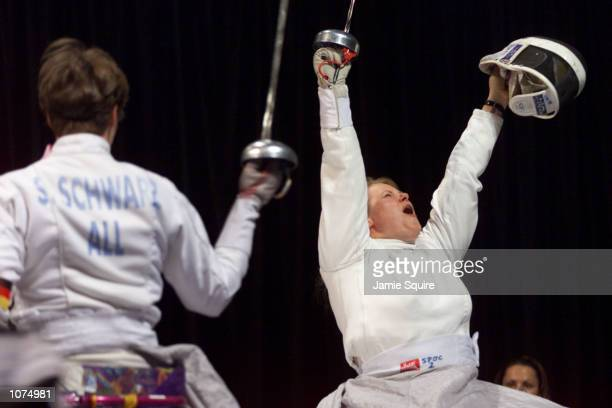 Jadwiga Polasik of Poland celebrates defeating Silke Schwarz of Germany to win the women's Team Epee Open Fencing gold medal at Pavilion Three at...