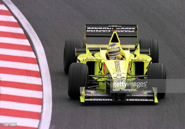 Jarno Trulli of Italy and Jordan during the second free practice session for the Japanese Grand Prix at Suzuka Japan Mandatory Credit Mark...