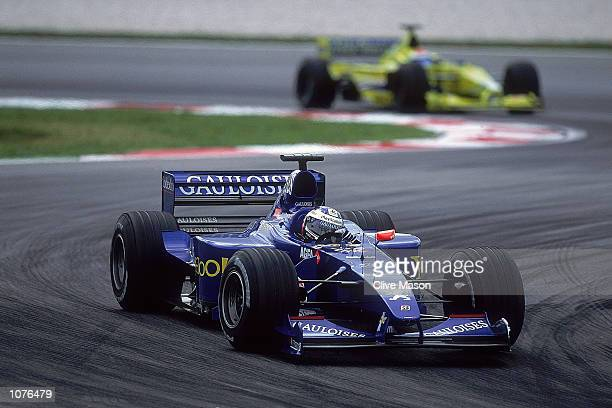 Jean Alesi of France and ProstPeugeot in action during the Malaysian Formula One Grand Prix at the Sepang Circuit in Kuala Lumpur Malaysia Mandatory...