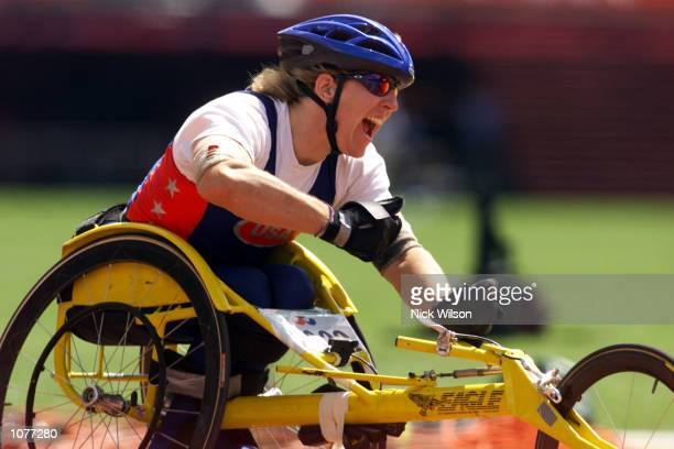 Jean Driscoll of USA celebrates winning Gold in the Womens Marathon T54 Final during the Sydney 2000 Paralympic Games at the Olympic Stadium,...