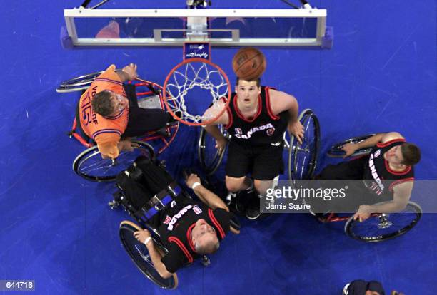 Joey Johnson of Canada prepares to rebound during the Mens Gold Medal Wheelchair Basketball Match between Canada and the Netherlands at the Superdome...