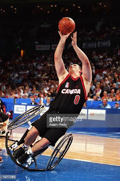 Joey Johnson of Canada takes an offbalance shot during the Netherlands v Canada Men's Wheelchair Basketball match as part of the 2000 Sydney...