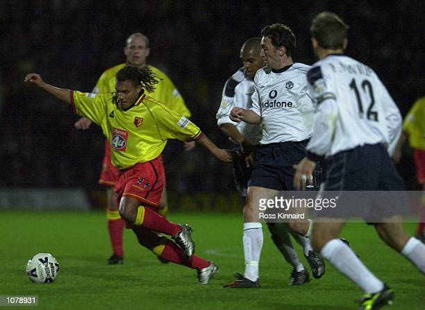 Jonathan Greening and Quinton Fortune of Manchester United close down Nordin Wooter of Watford during the Worthington Cup Third Round game between...