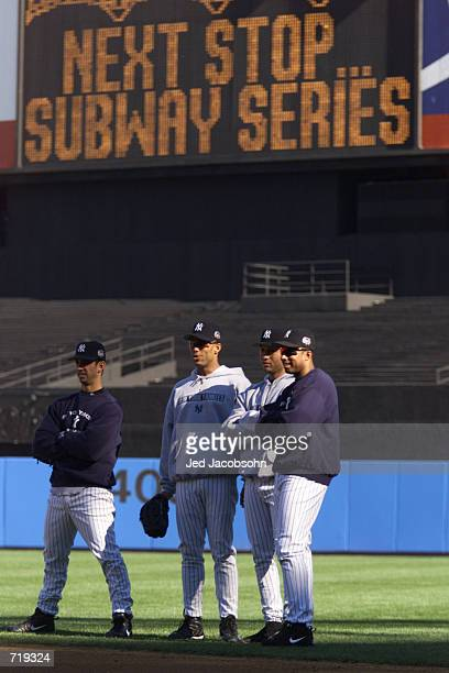 Jorge Posada David Justice Derek Jeter and Bernie Williams of the New York Yankees take infield practice the day before game 1 of the World Series...
