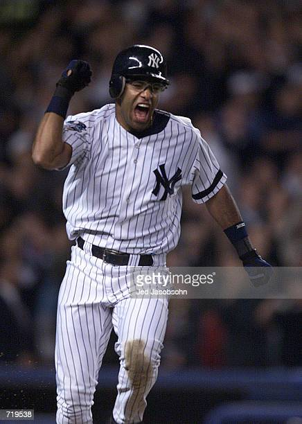 Jose Vizcaino of the New York Yankees celebrates driving in the winning run in the 12th inning against the New York Mets during game one of the World...