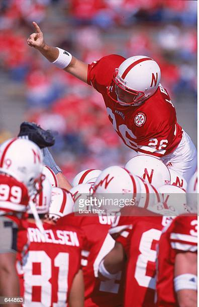 Josh Brown of the Nebraska Cornhuskers leaps up to ceebrate during the game against the Baylor Bears at the Memorial Stadium in Lincoln Nebraska The...
