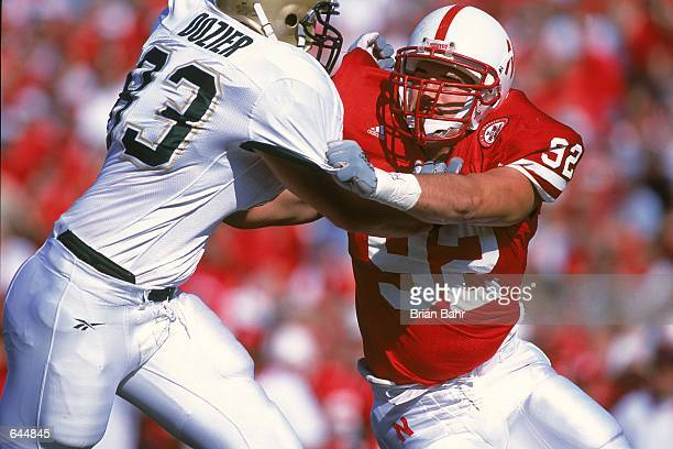 Justin Smith of the Nebraska Cornhuskers goes head to head against Anthony Dozier of the Baylor Bears during the game at the Memorial Stadium in...