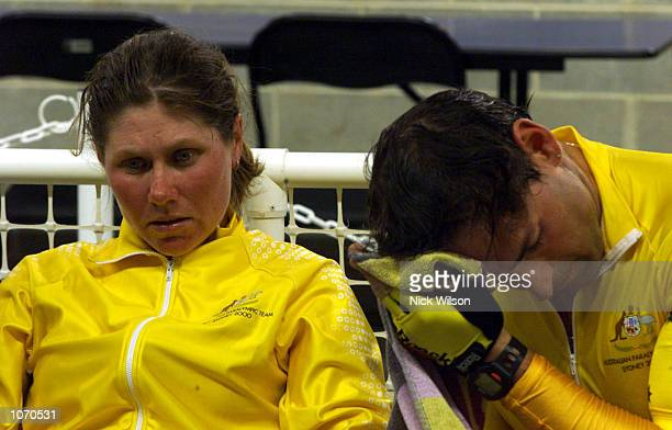 Kerry Modra and her husband Kieran Modra of Australia look on in disbelief as they are eliminated from the Mixed Tandem Sprint Open qualifying round...