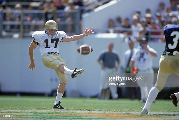 Kicker Joey Hildbold of the Notre Dame Fighting Irish punts the ball during the game against the Navy Midshipmen at the Citrus Bowl in Orlando,...