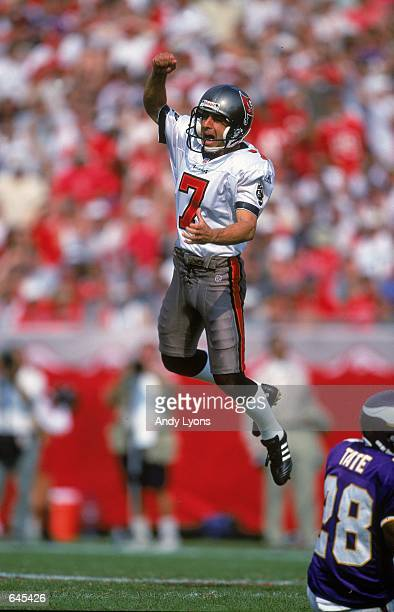 Kicker Martin Gramatica of the Tampa Bay Buccaneers celebrates on the field after his field goal during a game against the Minnesota Vikings at the...
