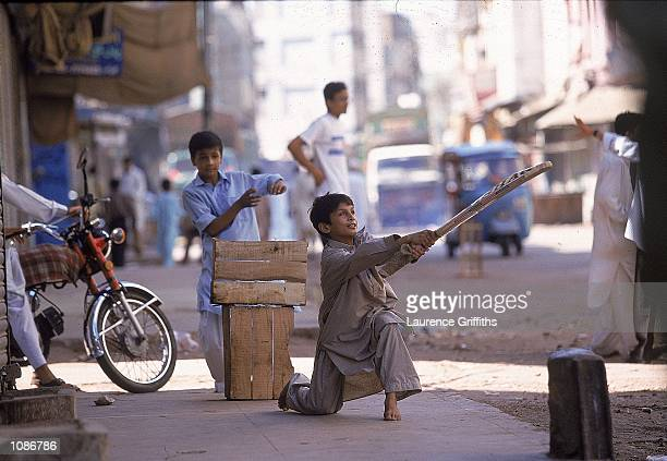 Kid's play cricket on the streets during England's tour to Pakistan held in Lahore Pakistan Mandatory Credit Laurence Griffiths /Allsport