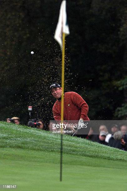 Lee Westwood chips from a bunker on his way to beating Colin Montgomerie in The Cisco World Match Play Championship played at Wentworth. Mandatory...