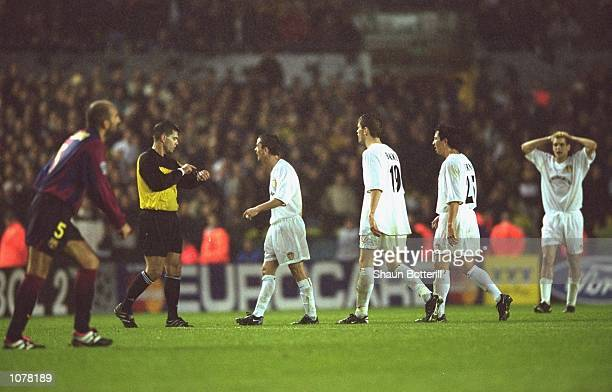 Leeds United players argue with the referee Terje Hauge during the UEFA Champions League match against Barcelona played at Elland Road in Leeds...