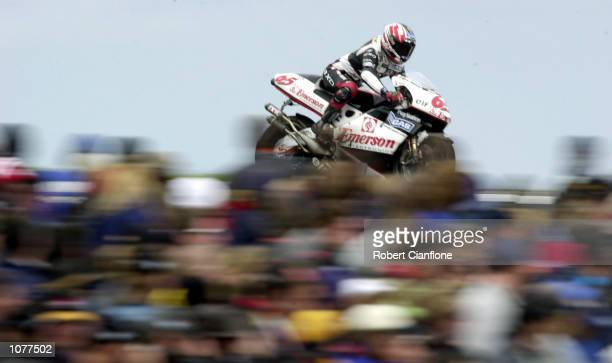 Loris Capirossi of Italy and the Emerson Honda Pons race team on his way to second place during the 500cc race at the Qantas Australian 500cc Grand...