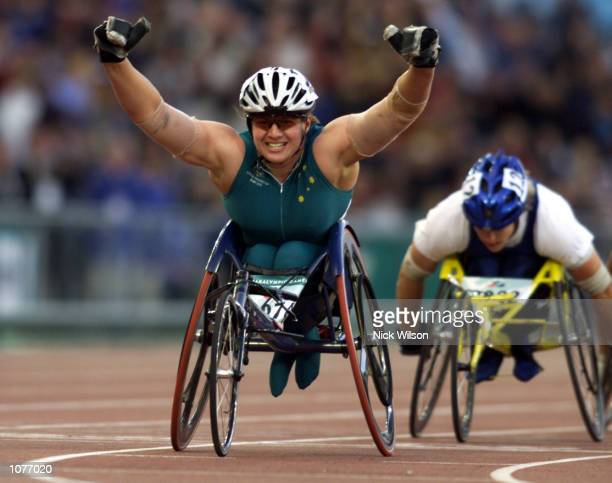 Louise Sauvage of Australia celebrates winning Gold in the Womens 5000m T54 Final at the Sydney 2000 Paralympic Games at the Olympic Stadium,...