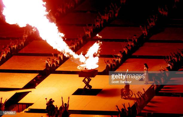 Louise Sauvage of Australia lights the cauldron during the opening of the Sydney 2000 Paralympic Games at Sydney Olympic Park, Sydney Australia....