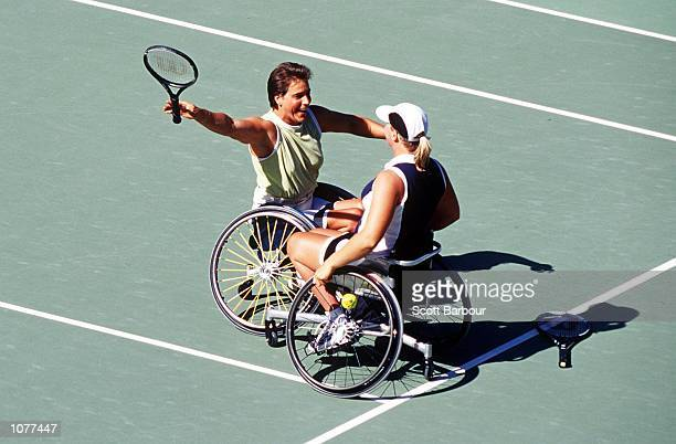 Maaike Smit and Esther Vergeer of the Netherlands Celebrate after defeating Branka Pupovac and Daniela Di Toro of Australia as part of the 2000...