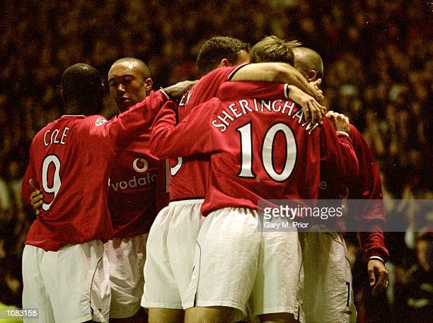 Manchester United celebrate during the UEFA Champions League match against PSV Eindhoven at Old Trafford in Manchester England Manchester United won...