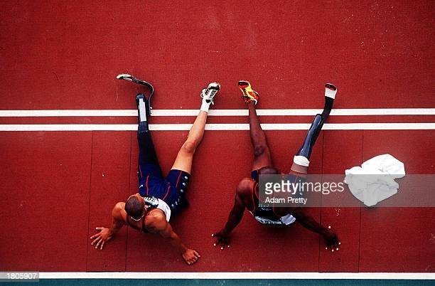 Marlon Ray Shirley and Roderick Green of the USA relax after competing in the Men's Long Jump final during the 2000 Sydney Paralympic Games at...