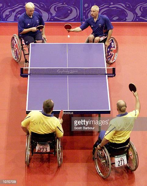 Martin Evans and Scott Robertson of Great Britain in action during their table tennis doubles match against JanKrister Gustavsson and Ernst Bollden...