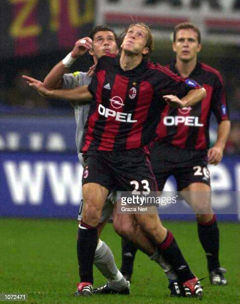 Massimo Ambrosini of AC Milan battles for possesion with Alesio Tacchinardi of Juventus during the Serie A match between AC Milan and Juventus at the...
