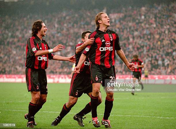 Massimo Ambrosini of AC Milan celebrates with team mates during the Italian Serie A game against Juventus played at the San Siro Stadium in Milan...
