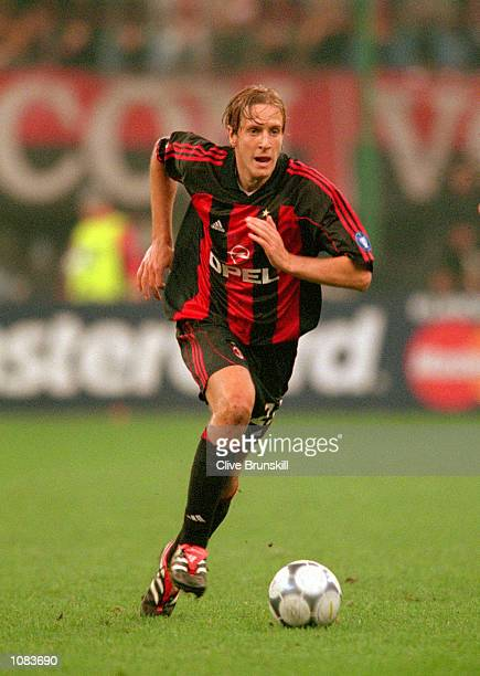 Massimo Ambrosini of AC Milan in action during the UEFA Champions League match against Barcelona at the San Siro in Milan Italy The match was drawn...