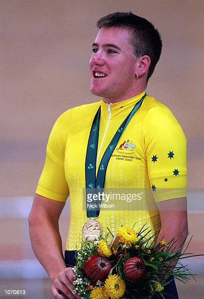 Matthew Gray of Australia celebrates winning the Gold Medal in the LC11000m Time Trial during the 2000 Paralympic Games at the Dunc Gray Veledrome in...