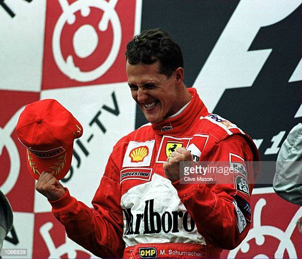 Michael Schumacher of Germany and Ferrari celebrates after winning the formula one world championship at the Japanese Grand Prix at Suzuka Japan...