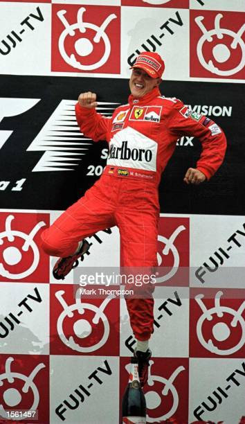 Michael Schumacher of Germany and Ferrari celebrates on the podium after winning the formula one world championship at the Japanese Grand Prix at...