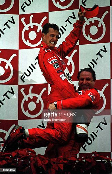 Michael Schumacher of Germany and Ferrari celebrates with Jean Todt after winning the formula one world championship at the Japanese Grand Prix at...