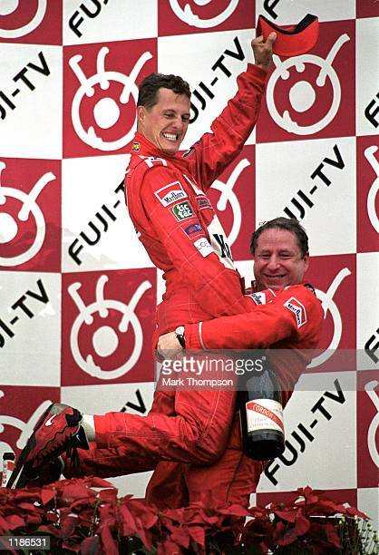 Michael Schumacher of Germany and the Ferrari team celebrates with Ferrari Team Principle Jean Todt after to winning the World Championship at the...