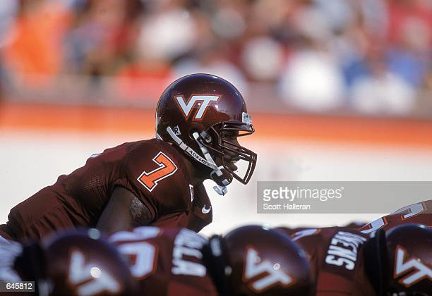 Michael Vick of the Virginia Tech Hokies calls the play during the game against the Pittsburgh Panthers at Blacksburgh, Virginia. The Hokies defeated...