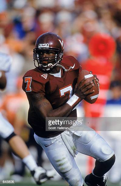Michael Vick of the Virginia Tech Hokies drops back to pass during the game against the Pittsburgh Panthers at Blacksburgh, Virginia. The Hokies...