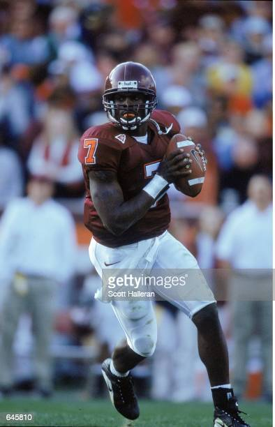 Michael Vick of the Virginia Tech Hokies lines up a pass during the game against the Pittsburgh Panthers at Blacksburgh Virginia The Hokies defeated...