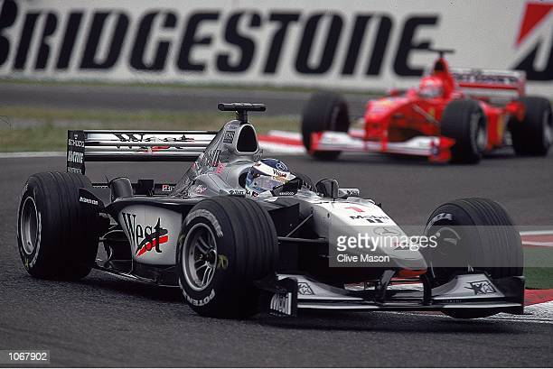 Mika Hakkinen of Finland and the McLaren Mercedes team leads from Michael Schumacher of Germany and the Ferrari team during the Japanese Formula One...