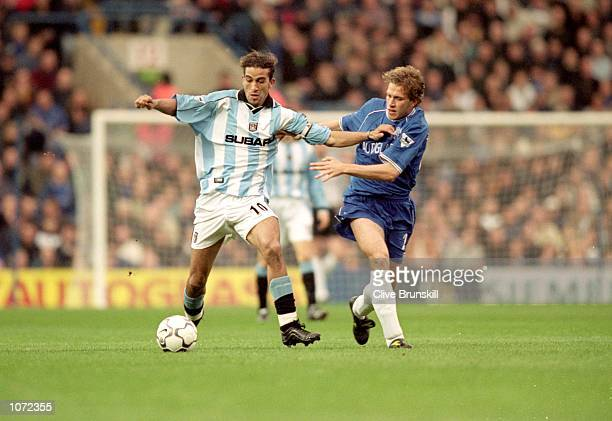 Mustapha Hadji of Coventry City holds off Sam Dalla Bona of Chelsea during the FA Carling Premiership match played at Stamford Bridge in London...