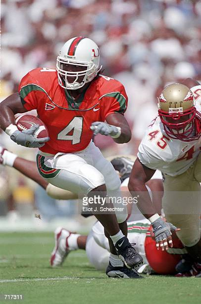 Najeh Davenport of the Miami Hurricanes runs with the ball during the game against the Florida State Seminoles at the Orange Bowl in Miami Florida...