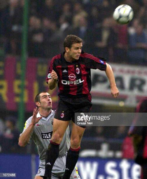 Oliver Bierhoff of AC Milan wins a header over Igor Tudor of Juventus during the Serie A match between AC Milan and Juventus at the San Siro Stadium...