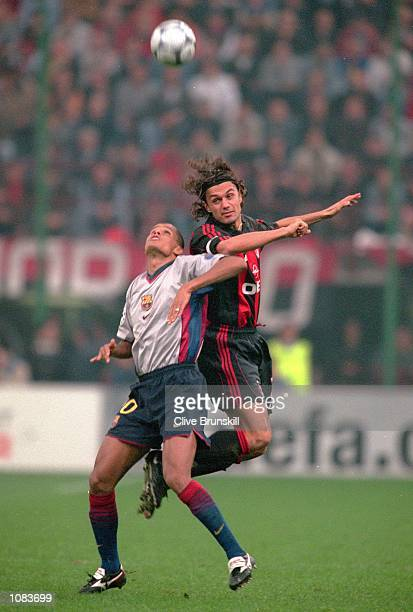 Paolo Maldini of AC Milan outjumps Rivaldo of Barcelona during the UEFA Champions League match at the San Siro in Milan Italy The match was drawn 33...