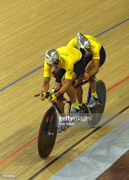 Paul Clohessy and Eddie Hollands of Australia in action during the Mens Tandem Individual Pursuit Open cycling during the Sydney 2000 Paralympics at...