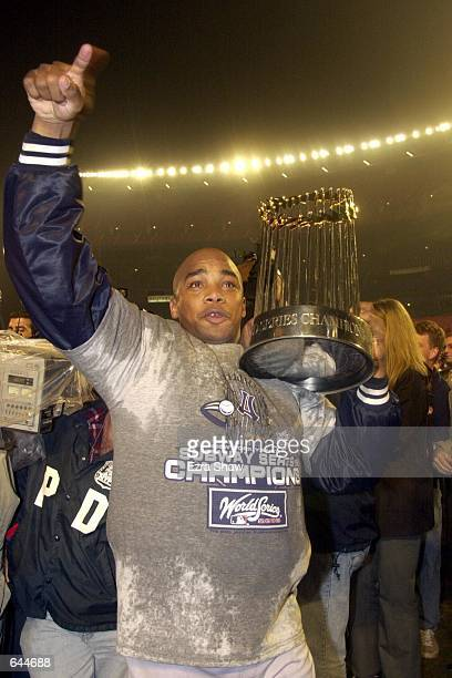 Pitcher Orlando Hernandez of the New York Yankees celebrates the teams'' 42 win and World Series Championship over the New York Mets during Game 5 of...