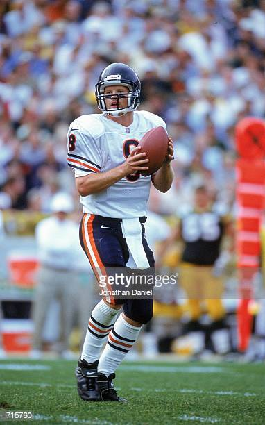 Quarterback Cade McNown of the Chicago Bears moves back to pass the ball during the game against the Green Bay Packers at Lambeau Field in Green Bay...